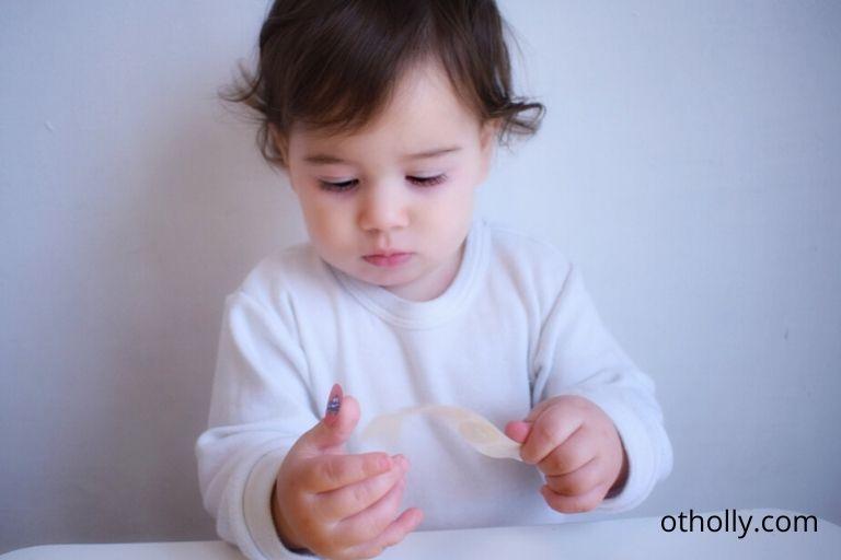 baby toddler sticking stickers