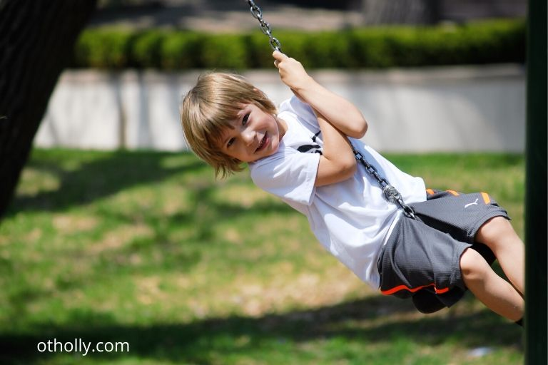 toddler on swing showing no sensory issues