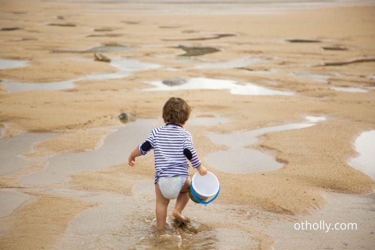 Toddler developing through walking in sand