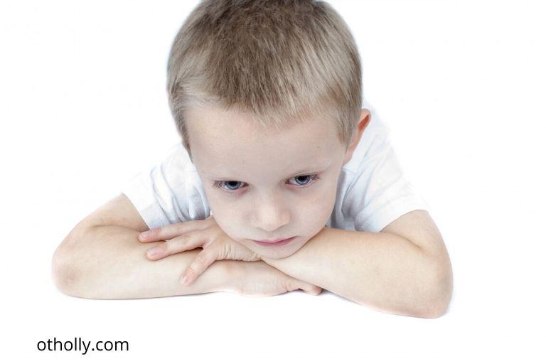 toddler looking sad