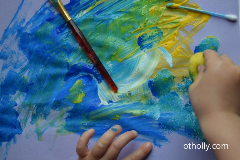 toddler painting with pom pom