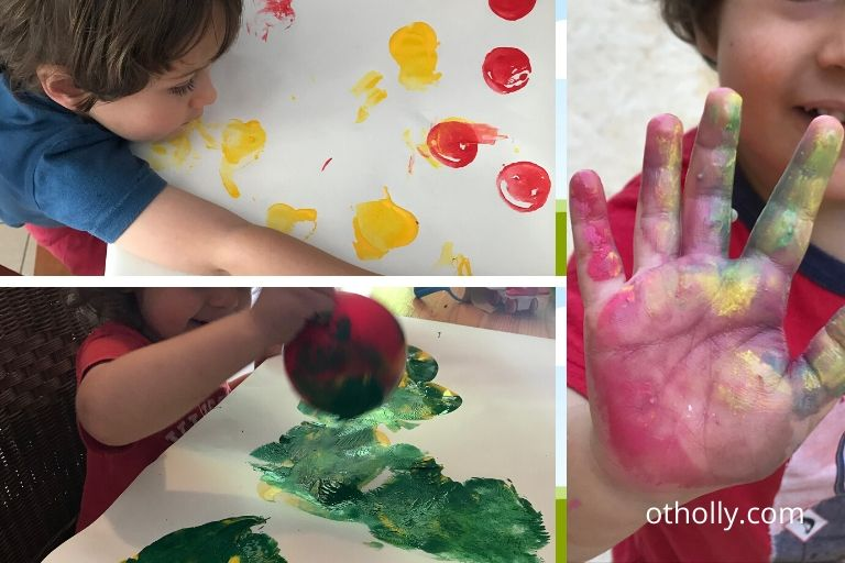 toddler painting with stamps, chalk and balloon