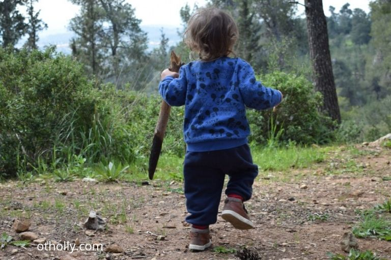 toddler running in forest