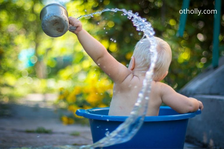 toddler washing in bucket