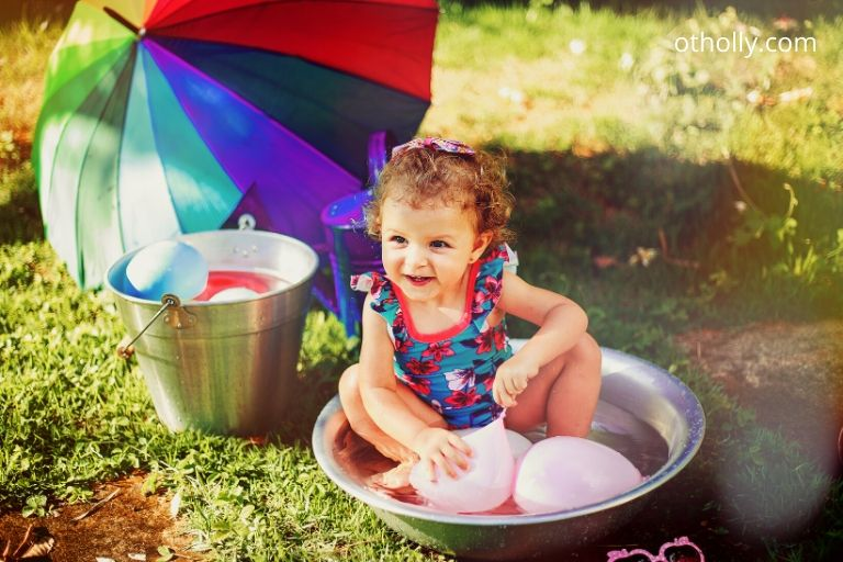 toddler playing in water and soap