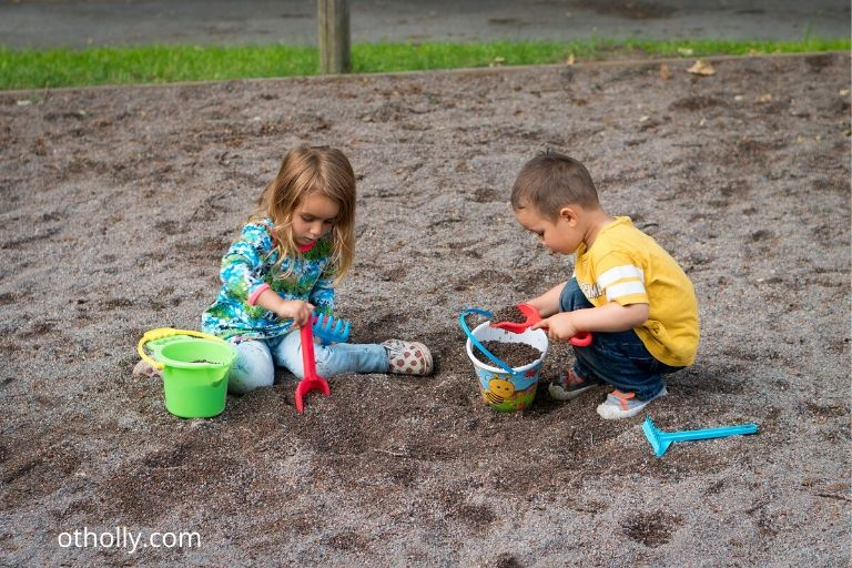 toddlers playing in the sand