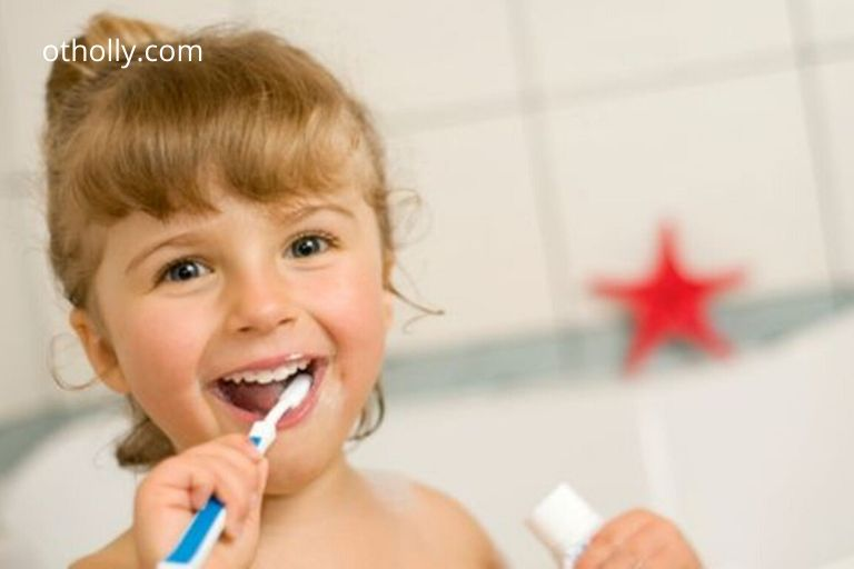 toddler brushing her teeth
