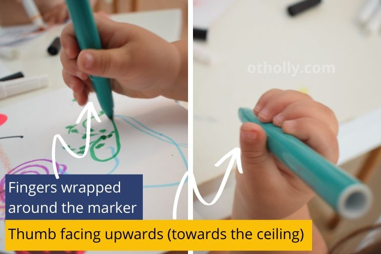 Description photo of a 1 year olds pencil grip. Showing hand grasp with thumb facing upward.