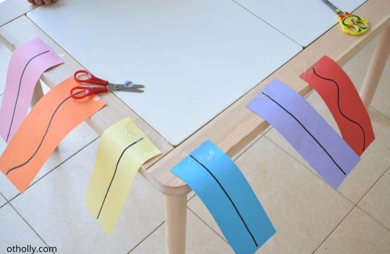 Paper strips cutting displayed for preschooler